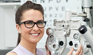 Image of student at the optometrist clinic with a machine
